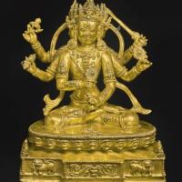 712. a gilt-bronze figure depicting a six-armed yidam tibet, 14th century