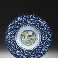 3. a dated faenza maiolica berettino dish dated 1536