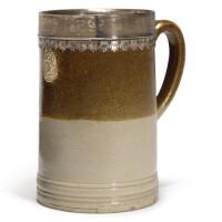 606. a london stoneware pint mug, with silver mount circa 1710-20 |