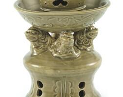 304. a rare yaozhou celadon 'lion' oil lamp northern song – yuan dynasty |