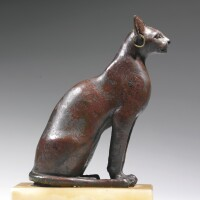 55. an egyptian bronze figure of a cat, 21st/26th dynasty, 1075-525 b.c.