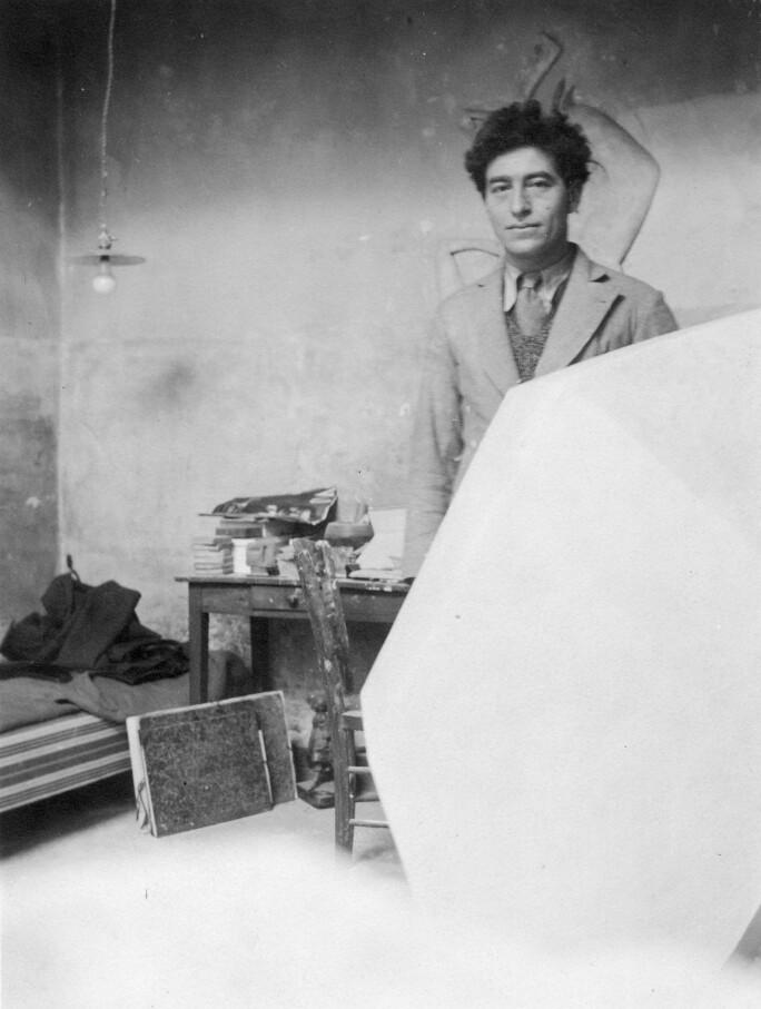Alberto Giacometti in his studio with the plaster sculpture \'Cube\', c.1933 (b/w photo)