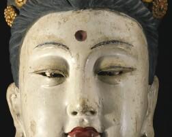 426. a polychrome stucco head of a female attendant china, jin / yuan dynasty
