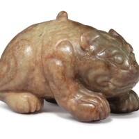 1216. a russet jade carving of a cat qing dynasty |