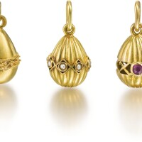 320. a group of five jewelled gold egg pendants, late 19th and early 20th centuries