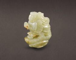 65. a pale celadon jade 'winged figure' finial jin– yuan dynasty