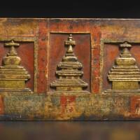 703. apolychromedand gilt-wood manuscript cover tibet, 14th century or earlier