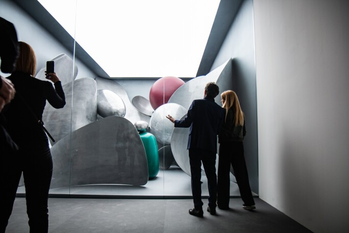 People looking at an art installation at the Venice Biennale.