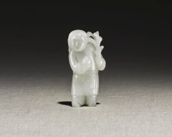 230. a white jade 'boy and lotus' figure 17th - 18th century |