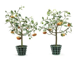 26. a pair of modern painted metal and porcelain orange trees and cache pots by carmen almon |