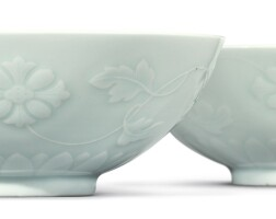 515. a pair of pale celadon-glazed molded 'floral' bowls yongzheng marks and period  