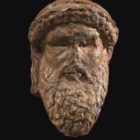 30. a roman giallo antico marble herm head of hermes, circa 1st century a.d.   a roman giallo antico marble herm head of hermes