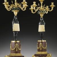 50. a pair of italian gilt-bronze,bronze and egyptian porphyry candelabra by francesco righetti (1749-1819), roman late 18th century