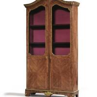 34. a french régence varnished bronze mounted tulipwood bookcase, circa 1720  