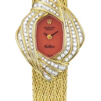15. rolex   cellini a yellow gold and diamond-set bracelet watch with coral dial, circa 1980