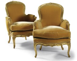 52. a pair of giltwood and yellow velvet padded bergères louis xv, mid 18th century
