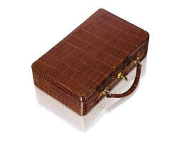 4. gold and leather jewelry case, cartier, paris
