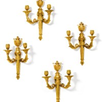 43. a suite of four gilt-bronze wall lights, north european work, late 18th century  