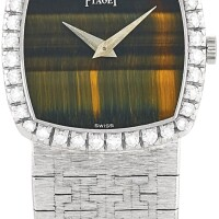 22. piaget | a white gold and diamond-set bracelet watch with tiger's eye hardstone dial, circa 1975