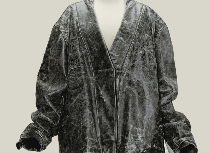 Martin Margiela black leather jacket in an auction selling luxury and vintage fashion