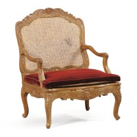 39. a french régence carved beechwood caned armchair, circa 1720  