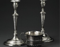 35. a pair of george iii candlesticks and a queen anne silver porringer, george ashworth, sheffield 1794, the porringer makers mark t a mullet below, london, circa 1700
