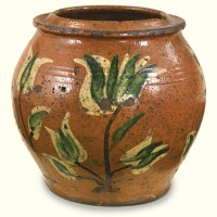 511. rare glazed red earthenware jar with tulip decoration, attributed to christian klinker (act. 1773-1798) nockamixon township, bucks county, pennsylvania, 1780-1795