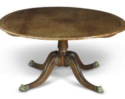 7. a regency gilt bronze-mounted, ebony inlaid mahogany center table, circa 1810