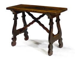 25. a small spanish walnut and chestnut trestle table 17th century