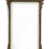 335. a george iii style parcel gilt and carved mahogany looking glass, colonial williamsburg reproduction |