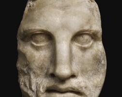 28. a hellenistic marble mask of sarapis, egypt, circa 1st century b.c.   a hellenistic marble mask of sarapis, egypt
