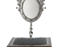 44. a polished steel mirror on rosewood stand