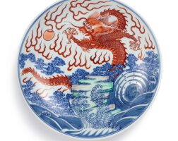 3604. a rare doucai and iron-red 'dragon' dish mark and period of kangxi |