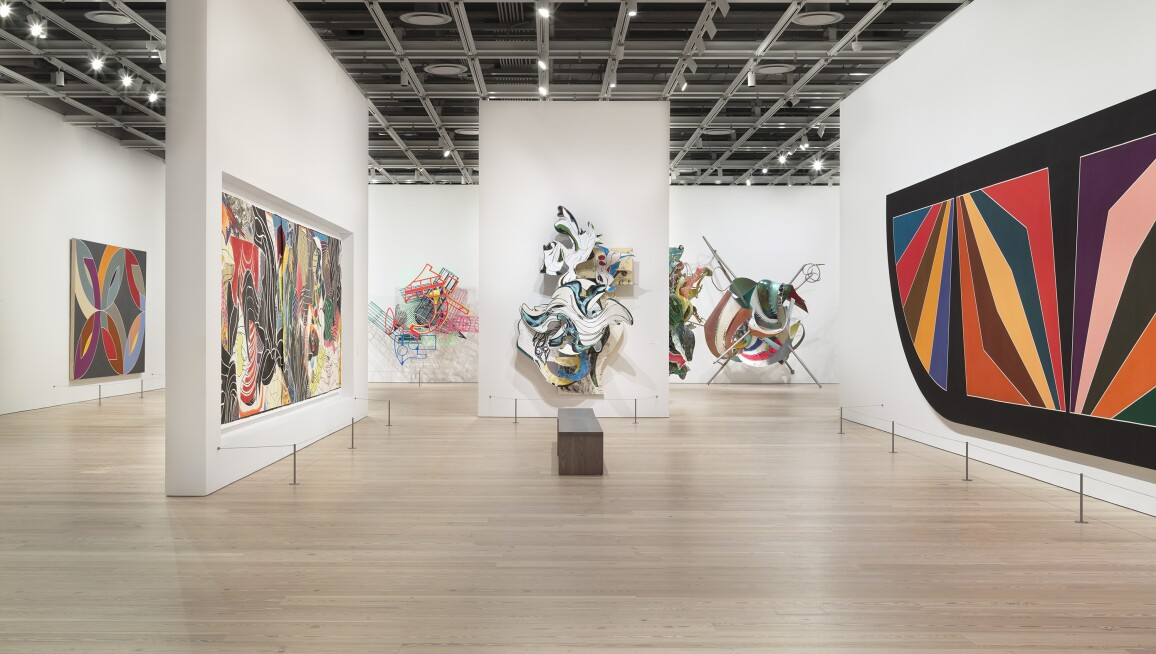 Frank Stella: A Retrospective, (left to right) Lac Laronge IV, 1969; The Fountain, 1992; La penna di hu, 1987-2009; The Grand Armada, 1989; At Sainte Luce!, 1998; K.81 combo (K.37 and K.43) large size, 2009; Damascus Gate (Stretch Variation III), 1970