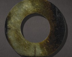 310. a yellowish-green and brown jade disc, huan probably shang dynasty