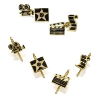 100. 18 karat gold and enamel 'movie' dress set