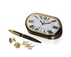 5. group of men's accessories, including cartier desk clock