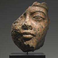 5. a fragmentary egyptian red granite head of amenhotep iii, 18th dynasty, reign of amenhotep iii, 1390-1353 b.c.