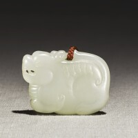264. a white jade 'mythical beast' pendant late qing dynasty  