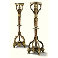 8. a pair of gilt-bronze-mounted, ebony veneered floral marquetry torchères