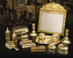 507. an assembled englishsilver-gilt chinoiserie dressing table set, crichton and other makers, london, 1916-18 and later |