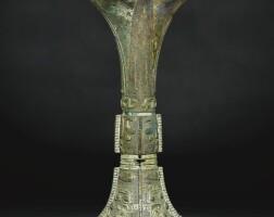 6. an impressive archaic bronze ritual wine vessel, gu late shang dynasty, 13th-11th century bc