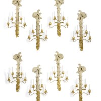 1215. a set of eight french parcel-gilt and white-painted metal four-branch wall lights, supplied by pierre delbée of maison jansen circa 1965, stamped jansen