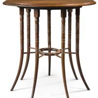 40. attributed to edward william godwin (for collinson and lock)   rare seven-legged centre table
