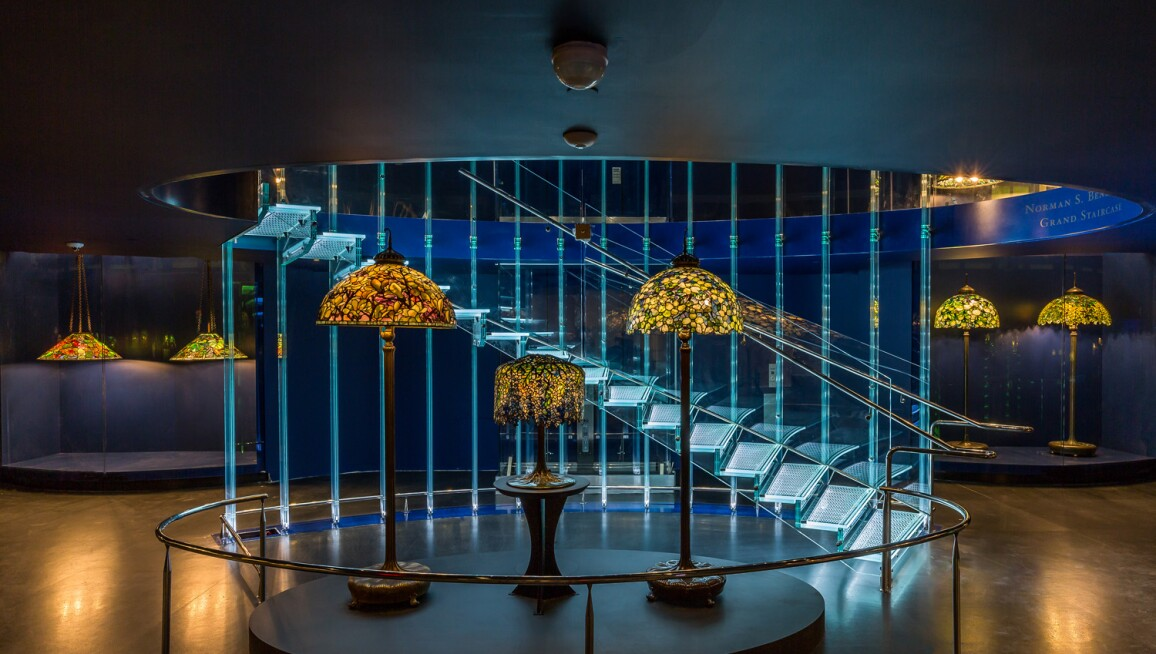 The Gallery of Tiffany Lamps, designed by renowned Czech architect Eva Jiřičná, comprises a 4,800-square-ft, two-story space measuring nearly a city block with its soaring glass Norman S Benzaquen Grand Staircase