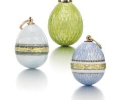 209. three enamel miniature egg pendants, circa 1900