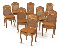 44. a suite of eight french régence caned carved beechwood chairs  