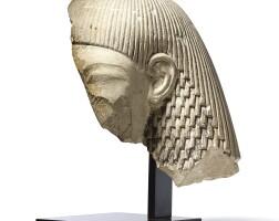 3010. an egyptian limestone fragmentary head of a man new kingdom, late 18th dynasty, circa 1350 b.c. |