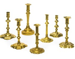 2. a group of seven miscellaneous brass candlesticks, 18th and 19th century