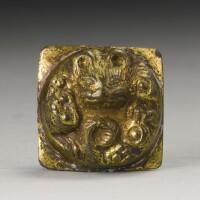 11. a gilt-bronze 'tiger' fitting han dynasty